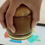 HANDle: A Novel Tangible Device for Hand Therapy Exergames